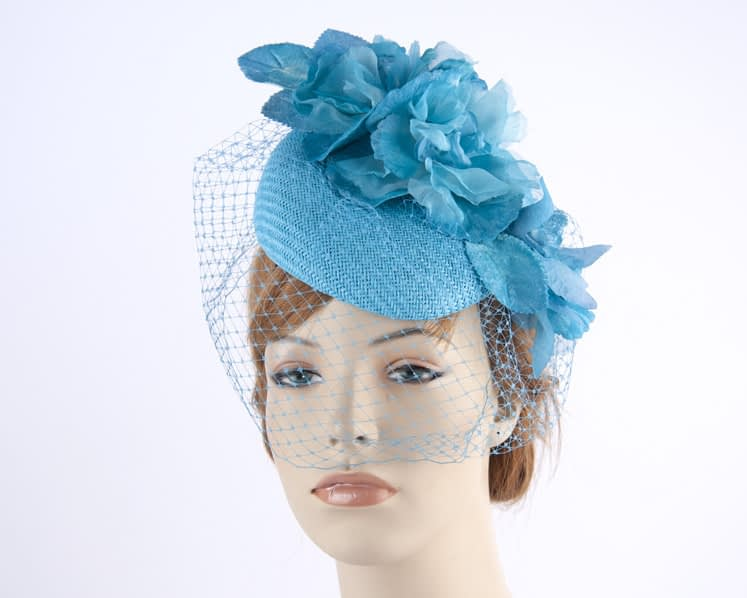 Turquoise pillbox with face veiling