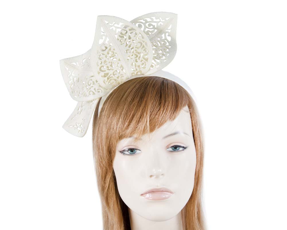 Modern cream racing fascinator by Max Alexander