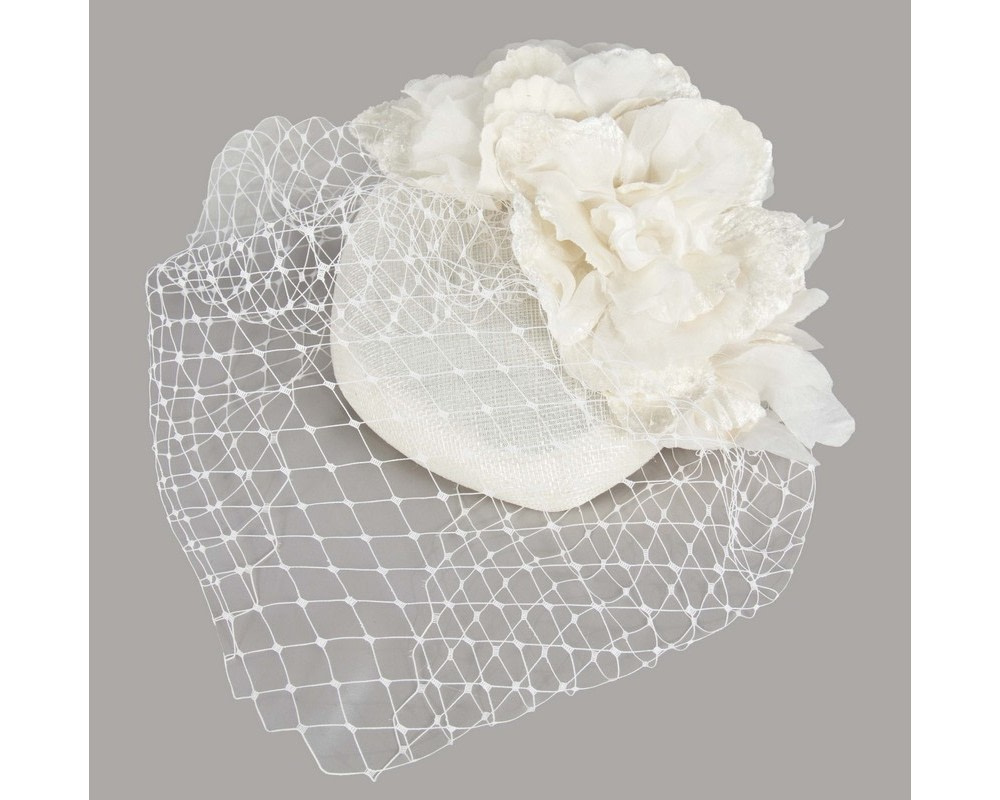 Cream pillbox with flower & veil by Fillies Collection