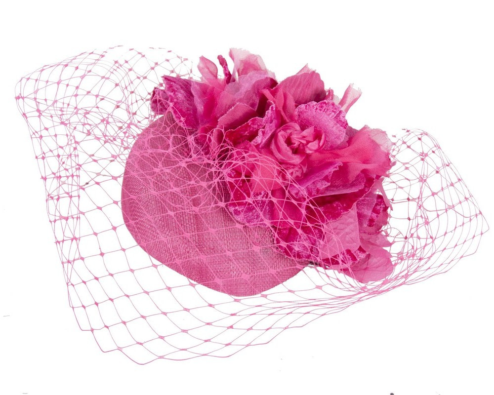 Fuchsia pillbox with flower & veil by Fillies Collection