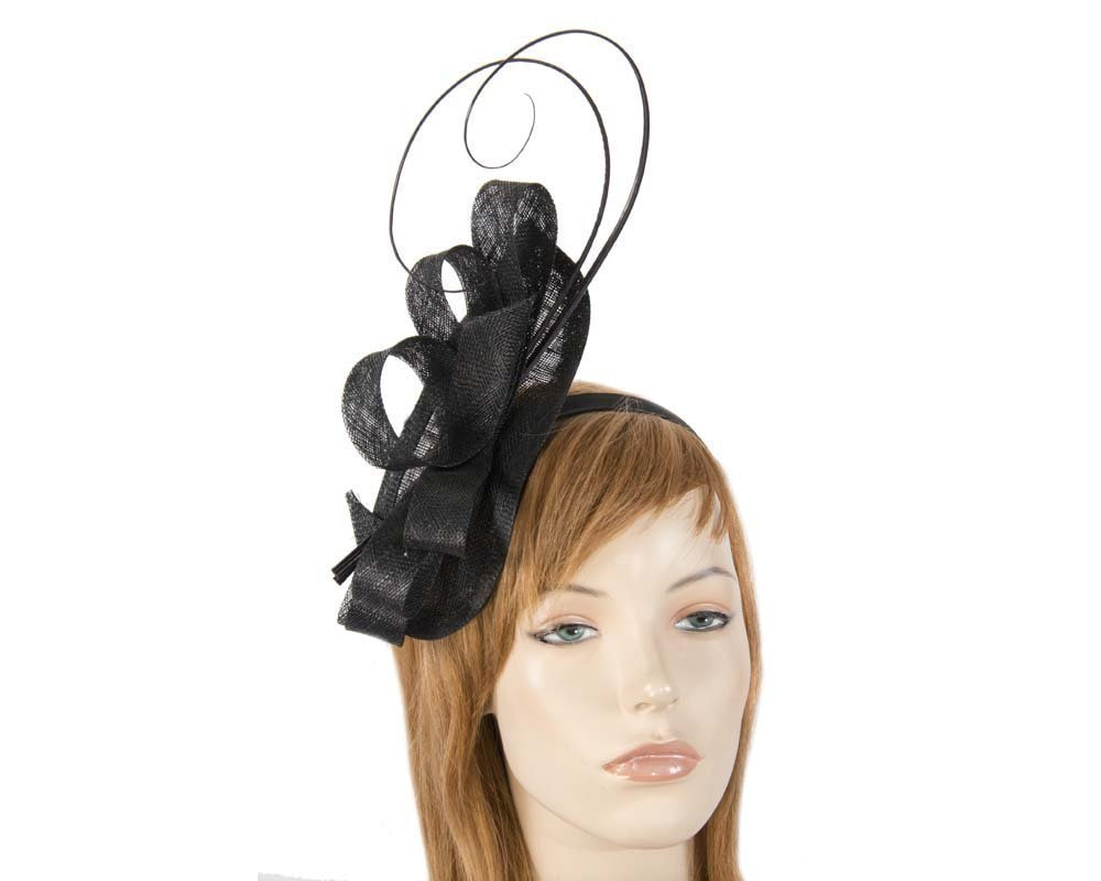 Black fascinator with long feather