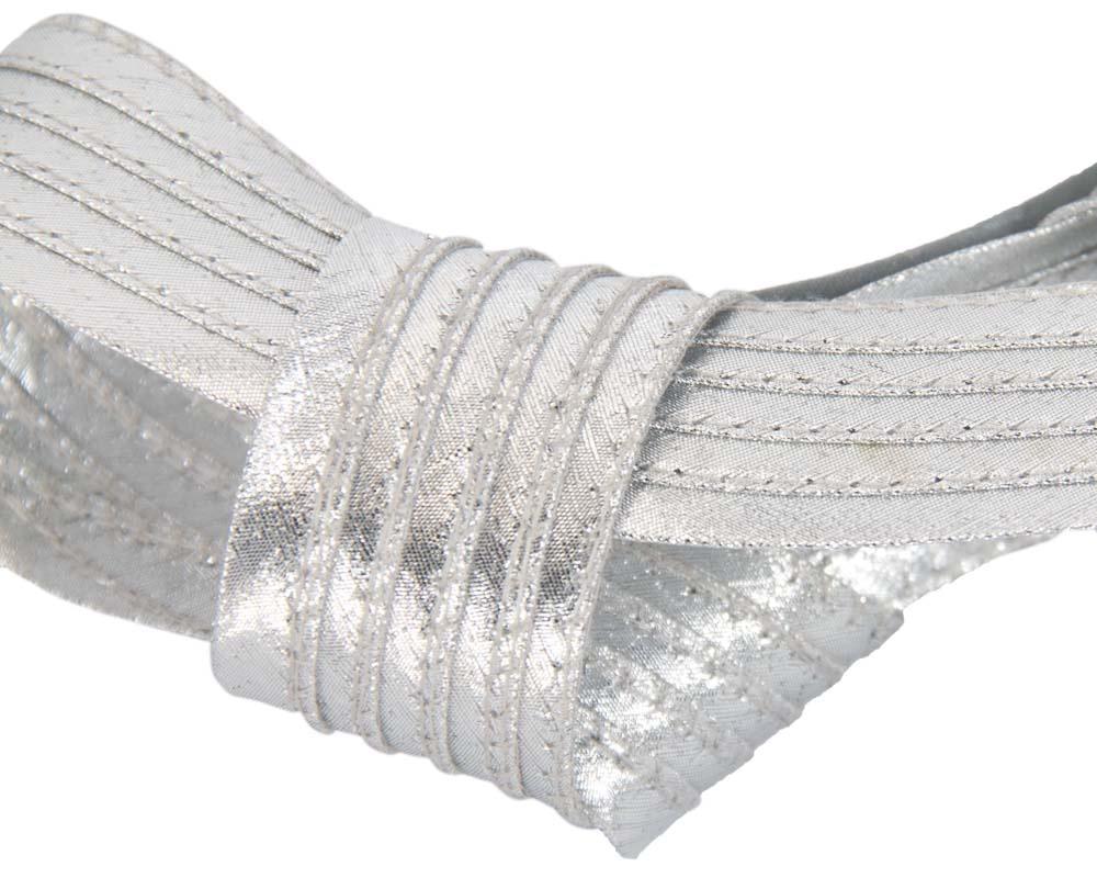 Curled metallic silver fascinator