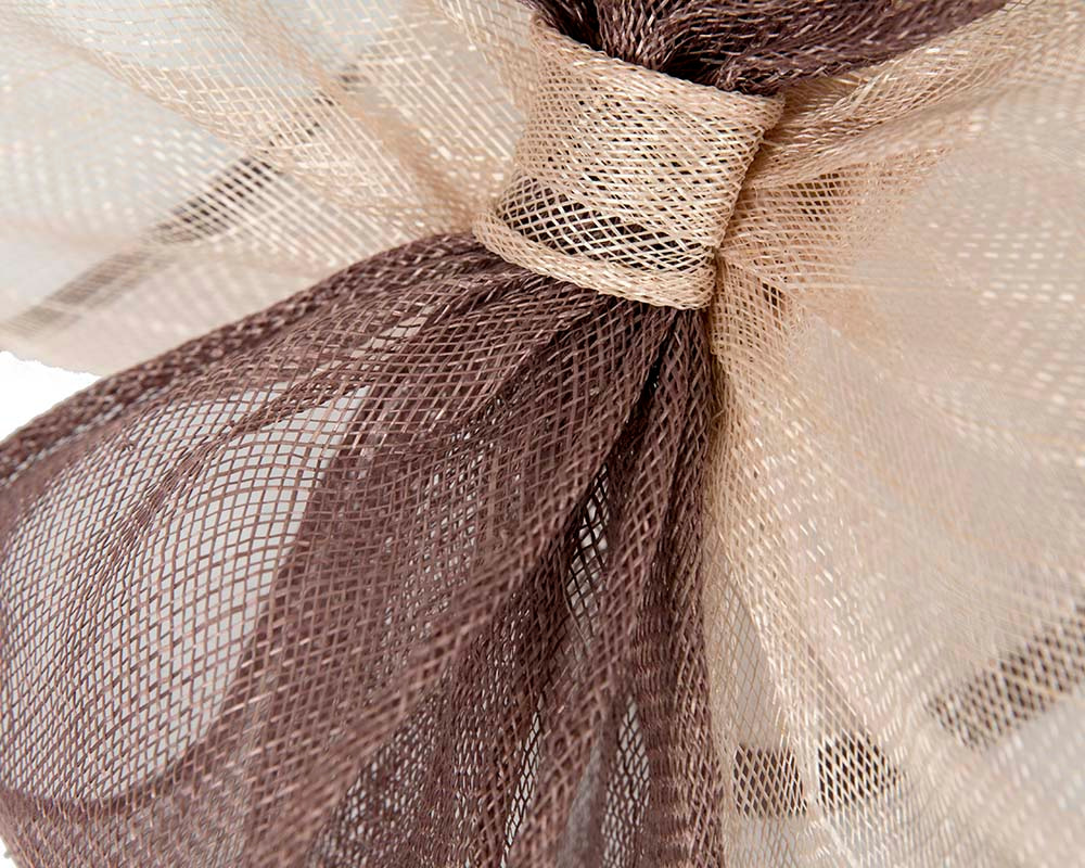 Large twisted nude racing fascinator by Cupids Millinery