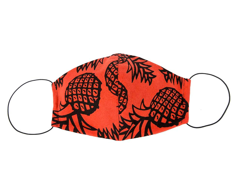Comfortable re-usable orange cotton jersey face mask with pineapples