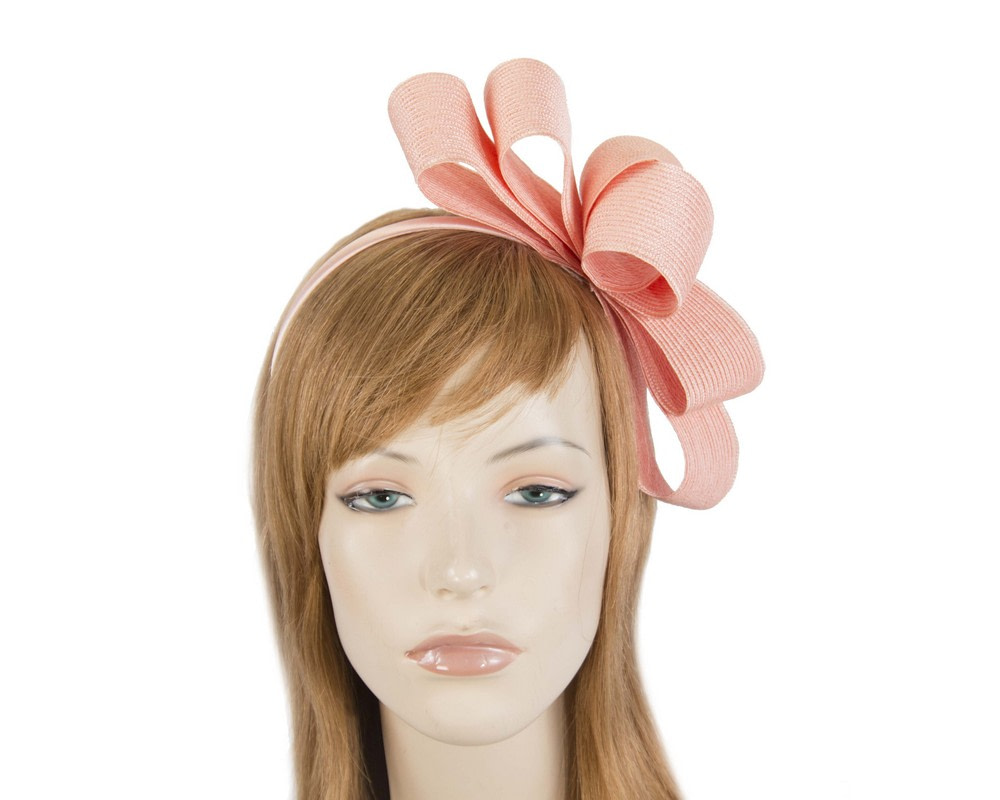 Coral bow fascinator by Max Alexander