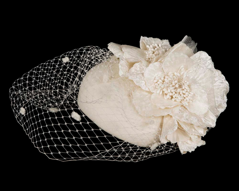 Cream winter racing felt pillbox with flower and veiling by Fillies Collection