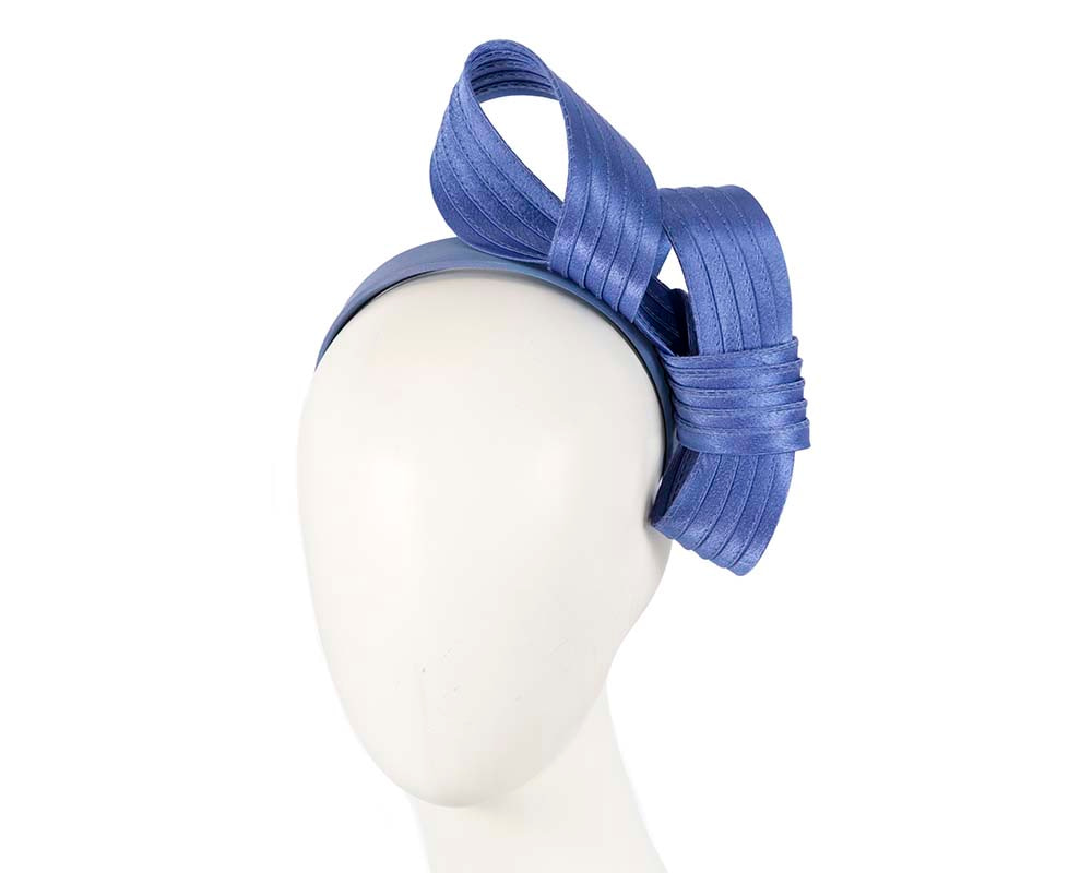 Curled blue fascinator by Max Alexander