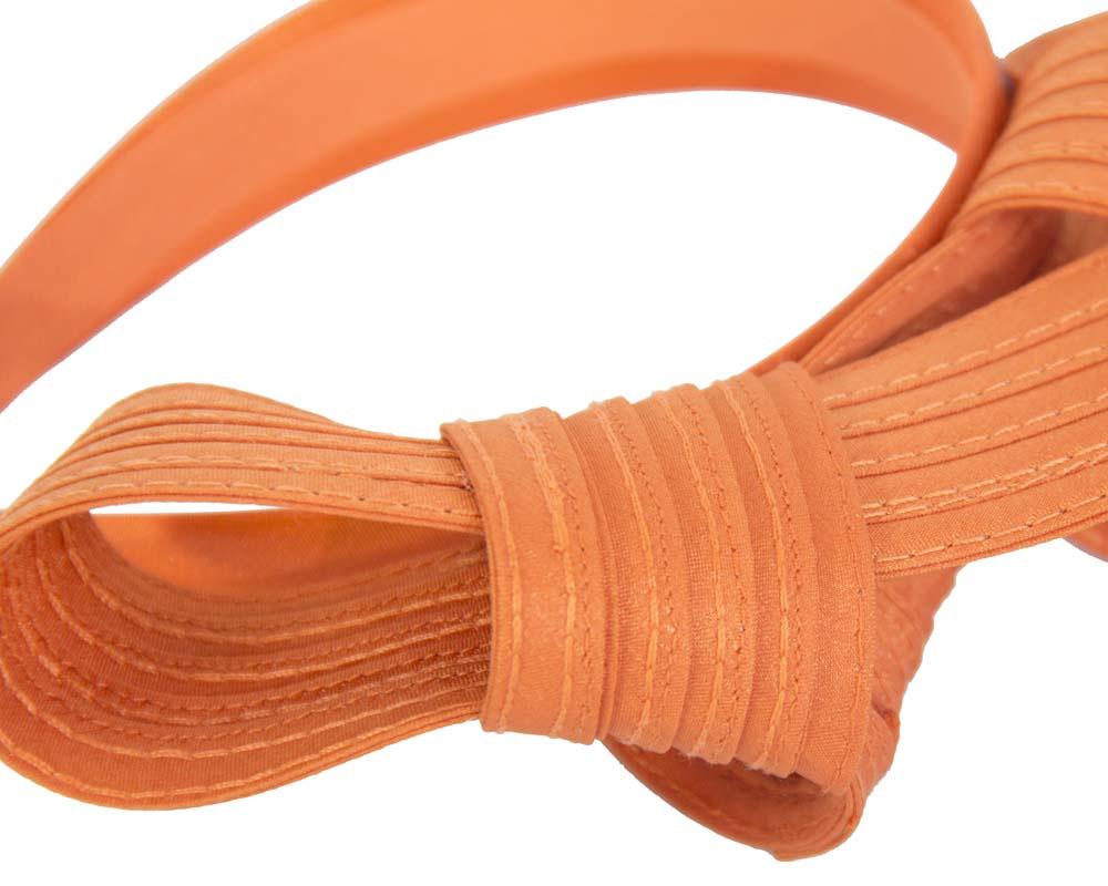 Curled orange fascinator