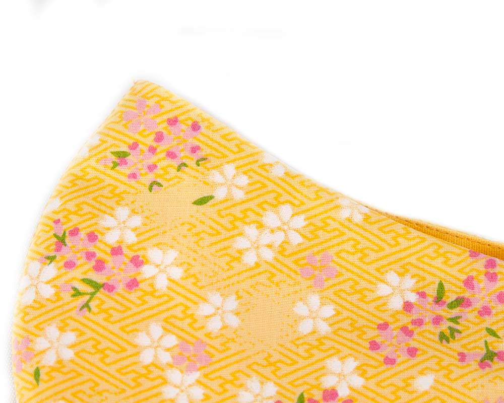 Comfortable re-usable yellow cotton face mask with flowers