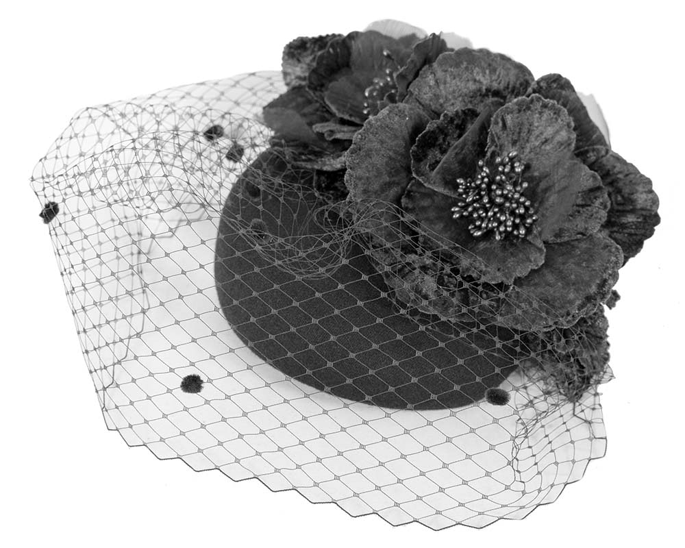 Black winter racing felt pillbox with flower and veiling by Fillies Collection