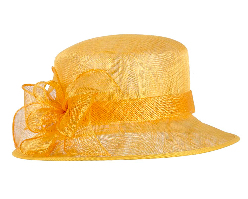 Yellow racing hat with bow by Cupids Millinery