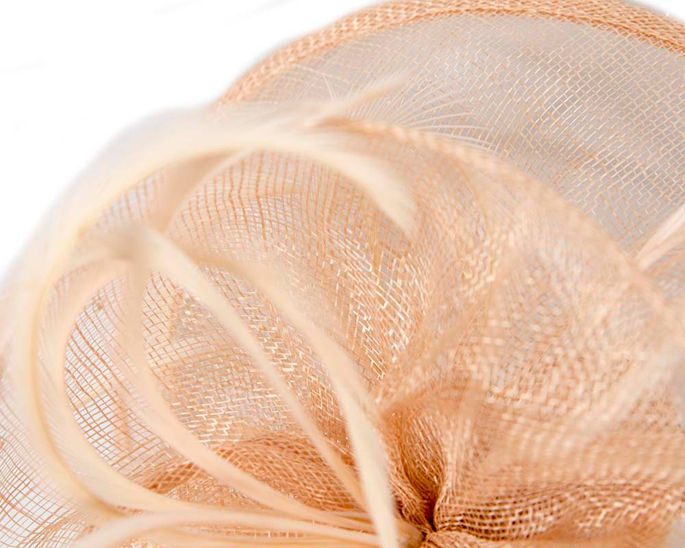 Stylish nude sinamay fascinator by Max Alexander