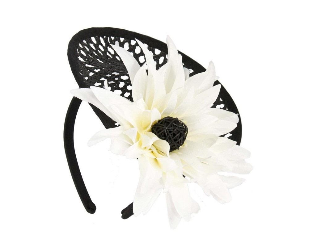 Black fascinator with cream flower