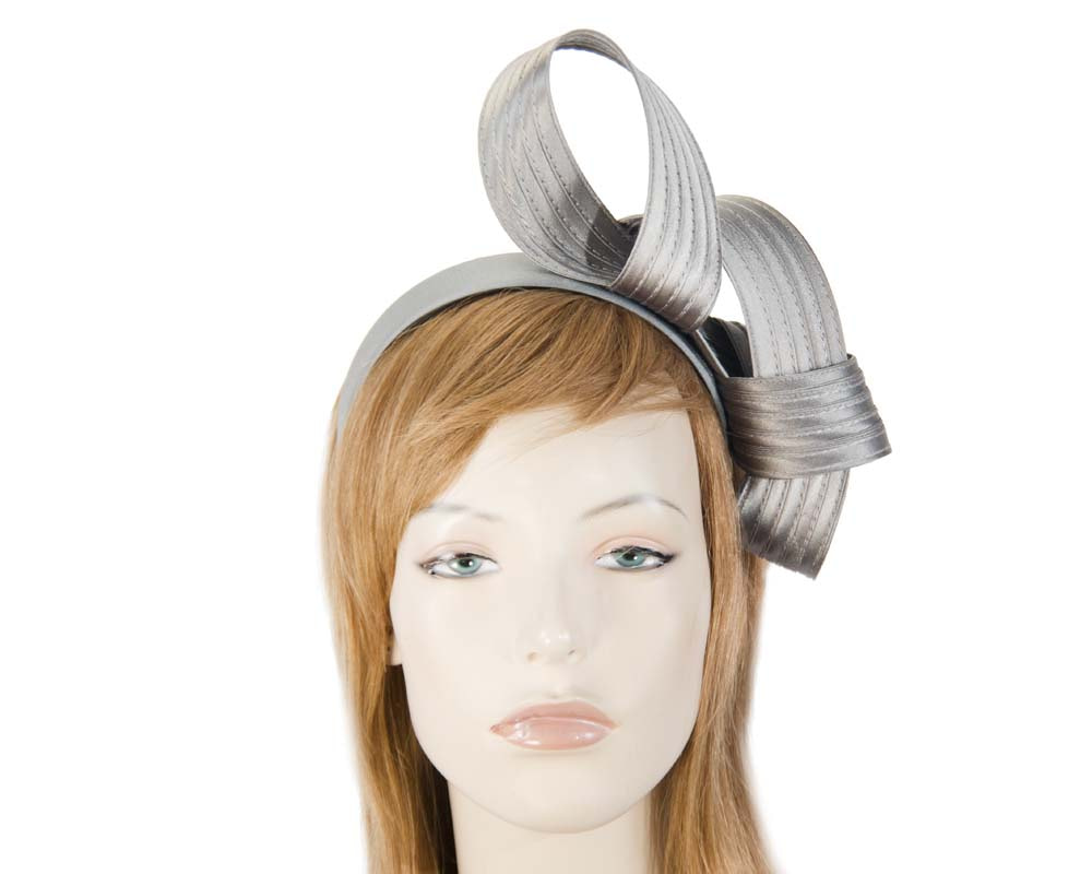 Curled silver fascinator