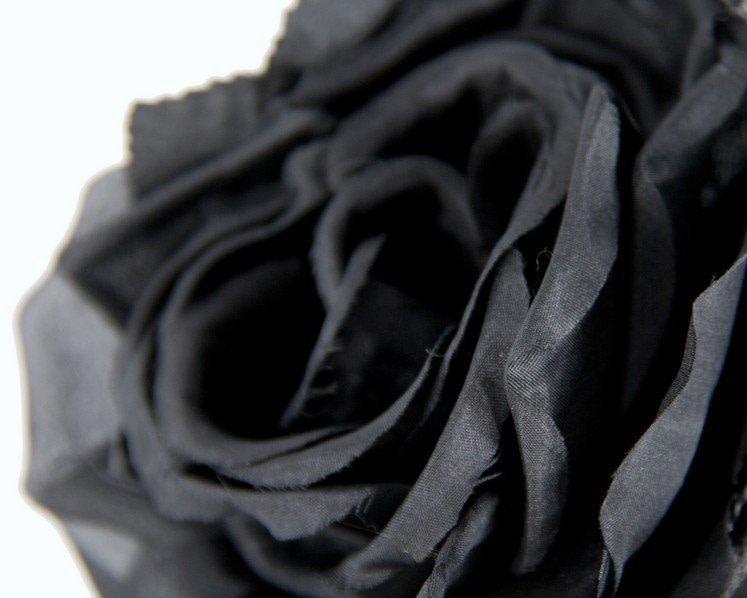 Black fascinator with flower