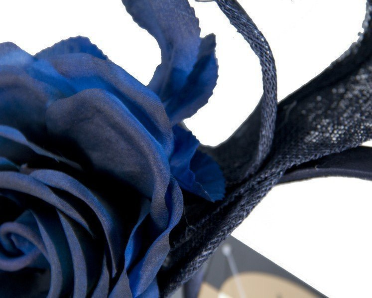 Tall navy fascinator with flower by Max Alexander