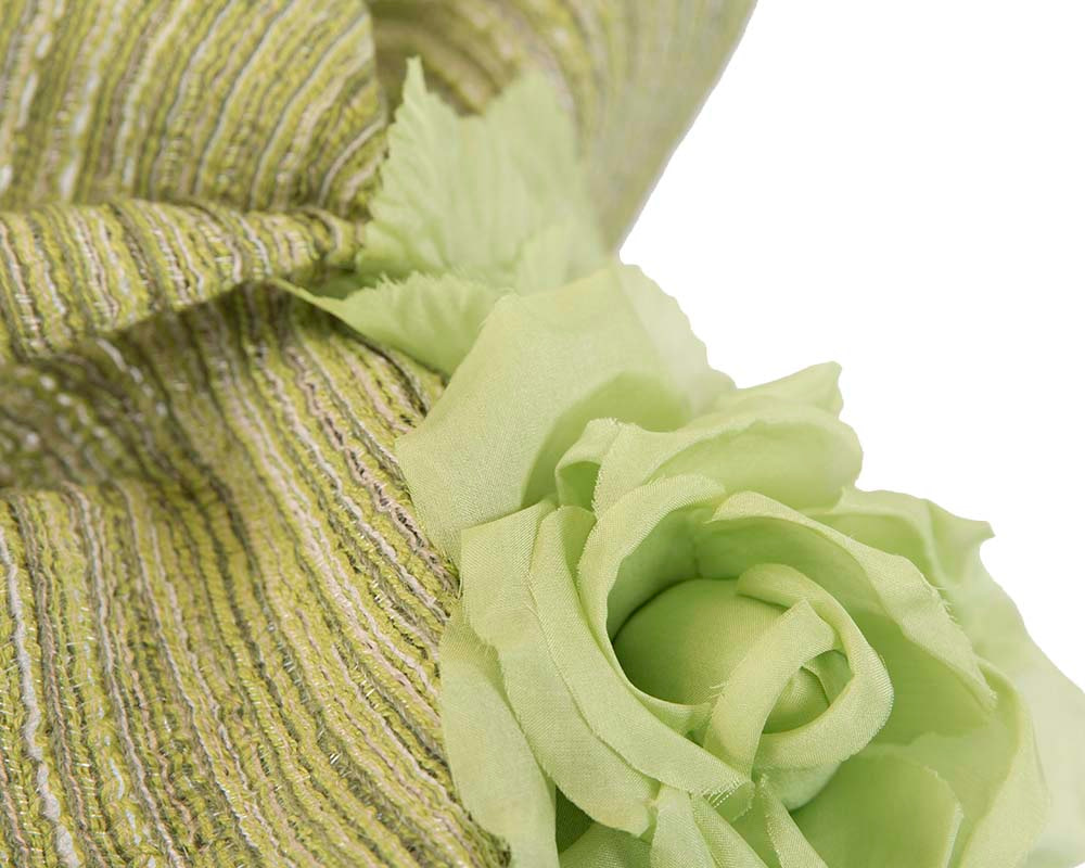 Exclusive large green fascinator with flowers