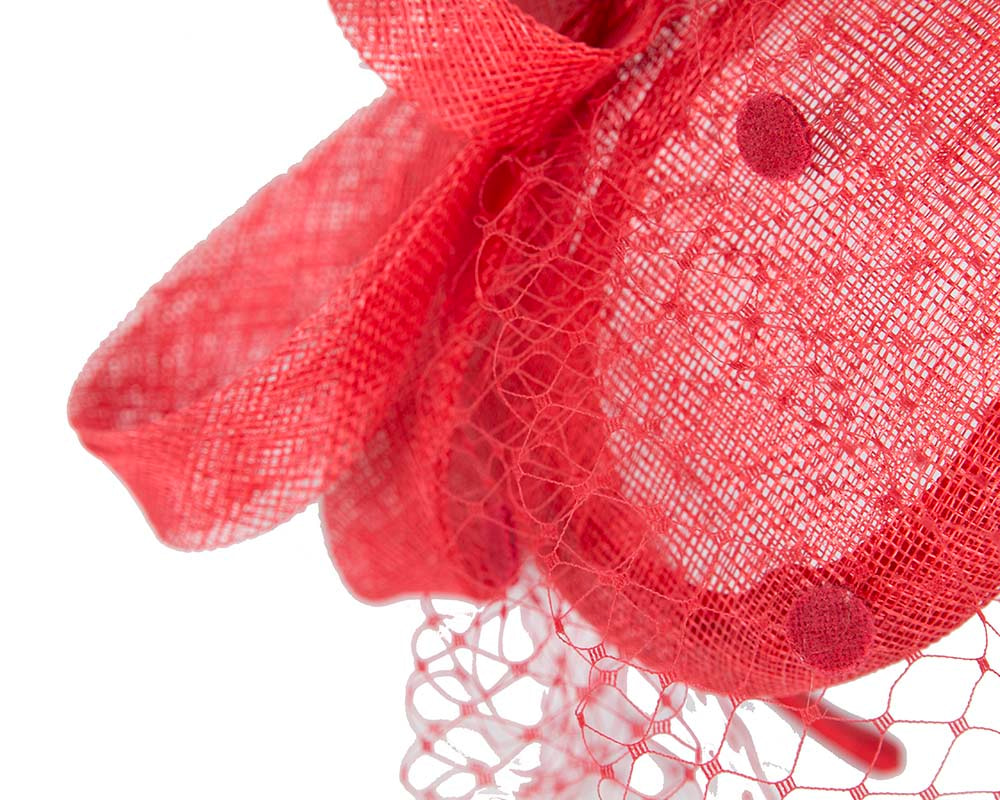 Red fascinator with face veil