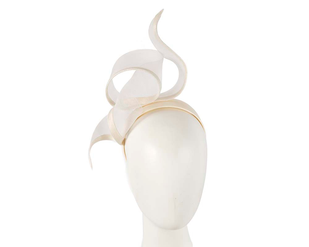Sculptured cream racing fascinator by Fillies Collection